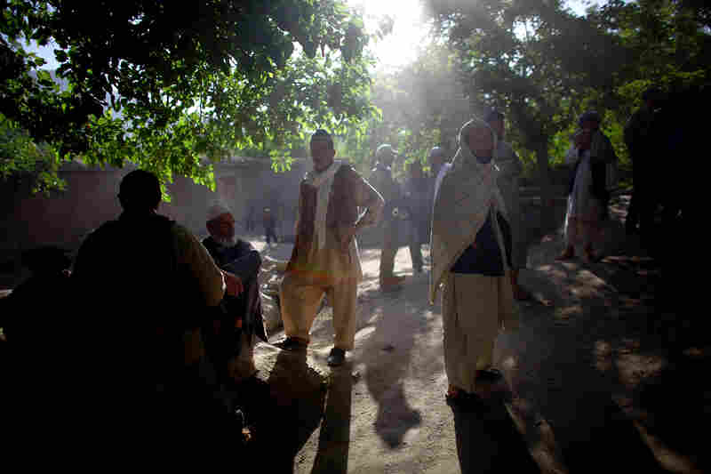 Villagers in Kasan gather to meet with Afghan local police and the Afghan National Army along with ANASF team members during a morning shura to discuss security.