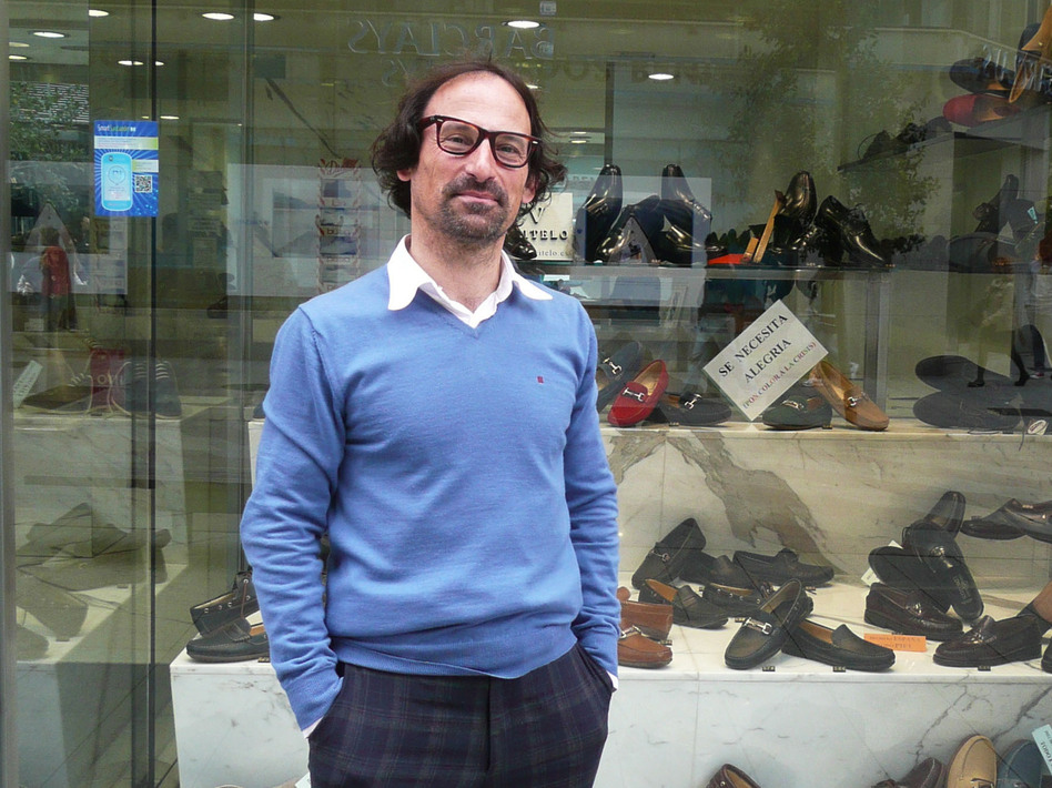 Angel Benito owns Benito's Shoes in Santander, a store that sells its wares online via the Smart Santander phone apps and campaign. (Lauren Frayer for NPR)