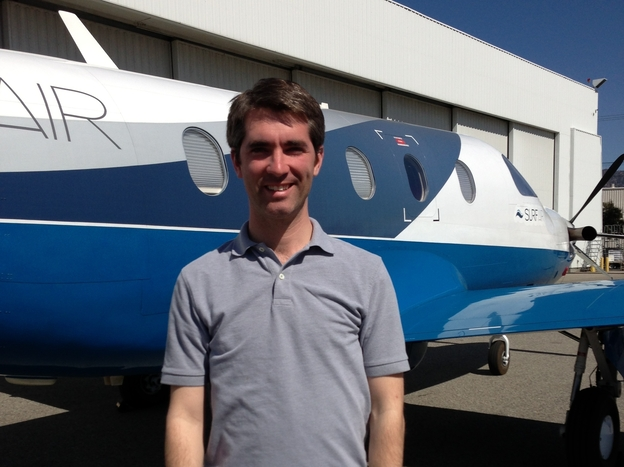 Surf Air CEO Wade Eyerly stands in front of one of the airline's turboprop planes in Burbank, Calif. Eyerly boasts that Surf Air will offer frequent commuters a corporate jet experience for not much more than regular airline prices.