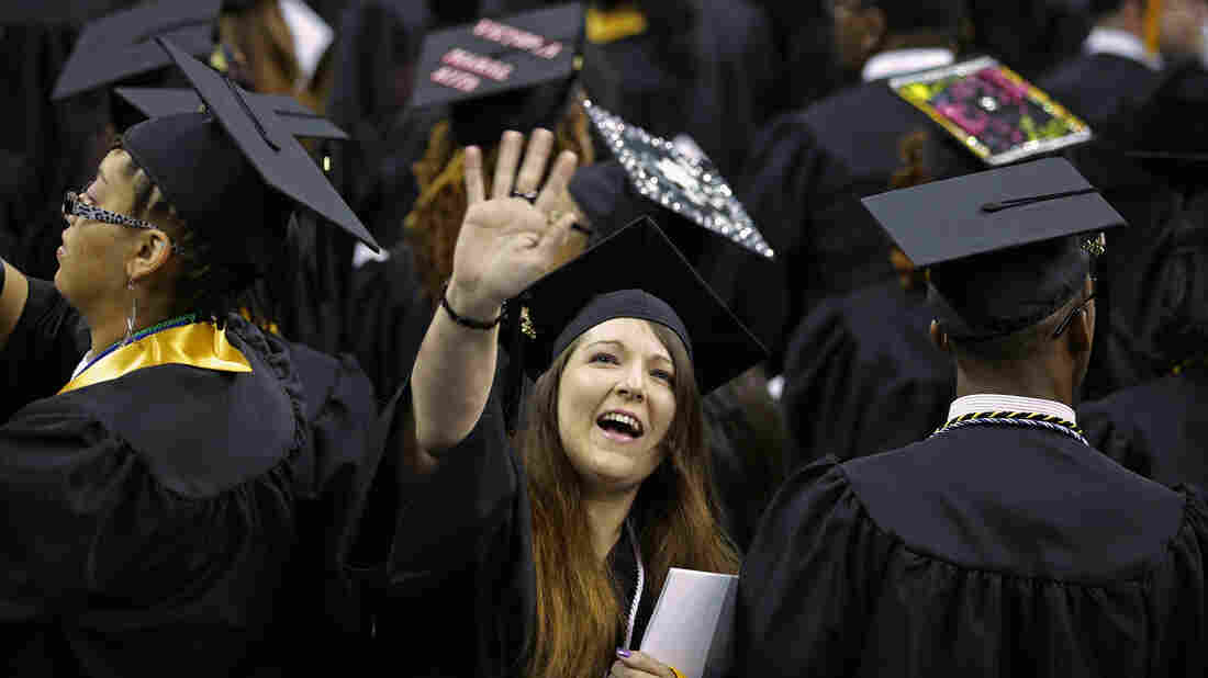 Graduates of Bowie State University wave to friends and family at the school's graduation ceremony in College Park, Md., on May 17. This year's graduates are finding better job prospect