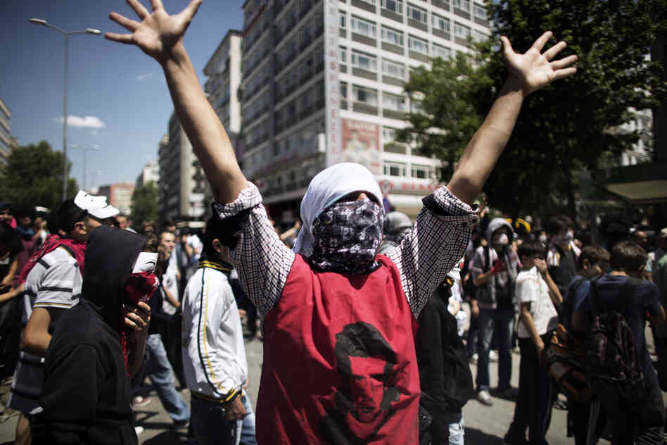 A Turkish demonstrator raises his hands during a protest held in front of the Prime Minister's office in central Ankara on Tuesday.