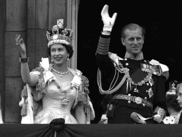 Cheers For The Queen ... And The Chicken: Britain's Queen Elizabeth II and Prince Philip, Duke of Edinburgh, greet supporters from the balcony at Buckingham Palace, following her coronation, June 2, 1953.