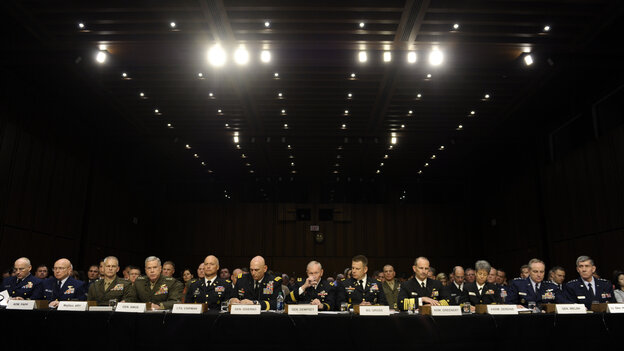Joint Chiefs Chairman Gen. Martin Dempsey (center) takes a drink of water as he and other members of the military testify before the Senate Armed Services Committee on Tuesday.