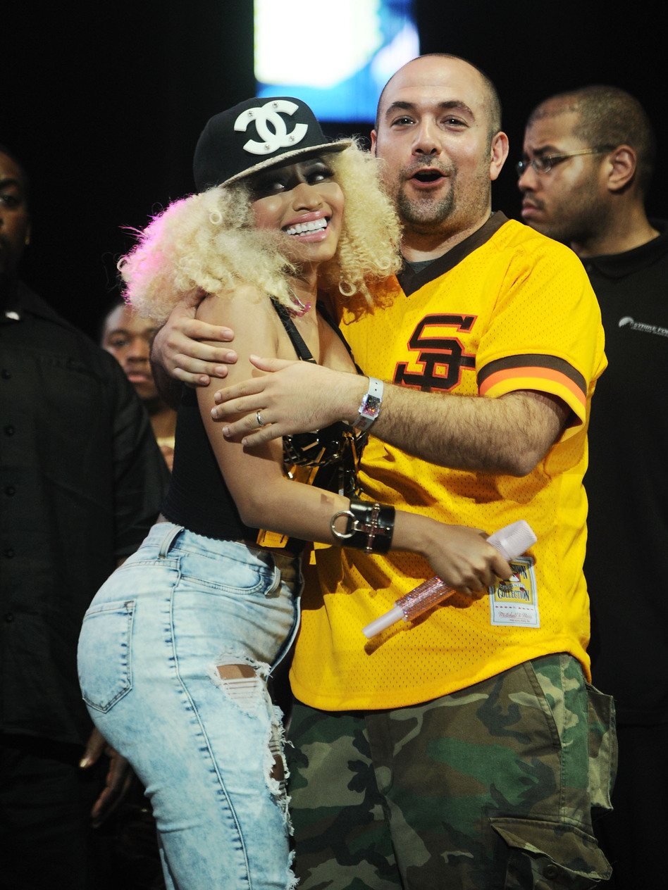"Nicki Minaj with Hot 97 host Peter Rosenberg after she performed at Summer Jam on Sunday. Last year, Minaj, Lil Wayne and the rest of their camp pulled out of scheduled performances after Rosenberg said, about Minaj's song, ""I know there are some chicks in here waiting to sing along with 'Starships' later. I'm not talking to y'all now. F--- that bulls---. I'm here to talk about real hip-hop s---."" (Getty Images)"