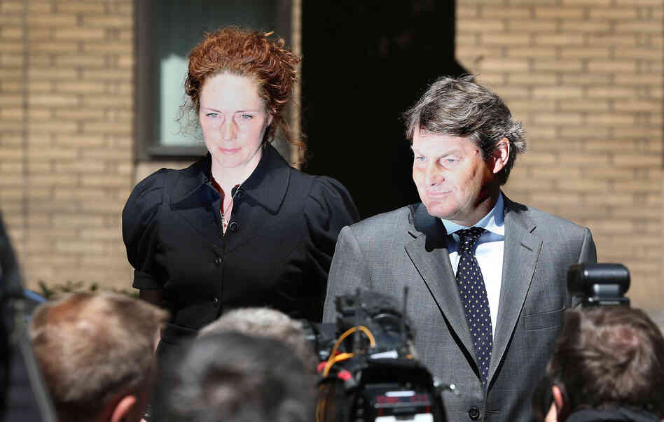 Rebekah Brooks, left, the former Chief Executive of News International, and her husband Charlie Brooks leave Southwark Crown Court on Wedn