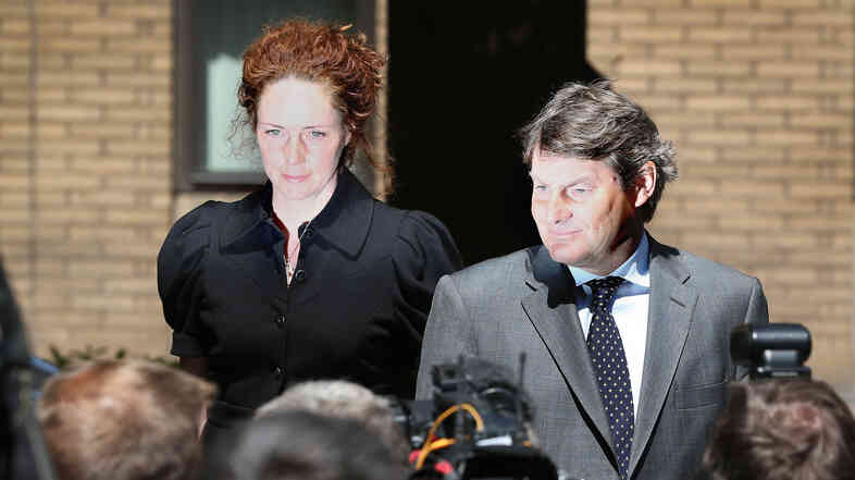 Rebekah Brooks, left, the former Chief Executive of News International, and her husband Charlie Brooks leave Southwark Cro