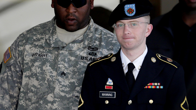 Army Pfc. Bradley Manning (right) is escorted out of a courthouse in Fort Meade, Md., on June 25, 2012. His lawyer announced that Manning, who is accused of leaking classified information to WikiLeaks, had agreed to plead guilty to lesser charges. (AP)