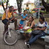 Residents socialize and children play in the tranquil plaza of Mage, a small town that has seen an increase in violence as pacification efforts in Rio de Janeiro are forcing drug traffickers out of the capital's favelas, or shantytowns.