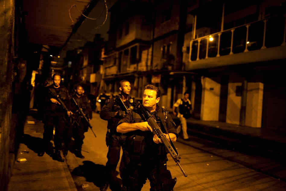 Rio de Janeiro's Elite Special Forces Police Unit patrols the Caju favela complex as part of the pacification program designed to crack down on crime in advance of the World Cup in 2014 and the Summer Olympics in 2016.