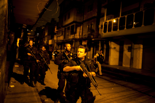 Rio de Janeiro's Elite Special Forces Police Unit patrols the Caju favela complex as part of the pacification program designed to crack down on crime in advance of the World Cup in 2014 and the Summer Olympics in 2016. (Lianne Milton for NPR)