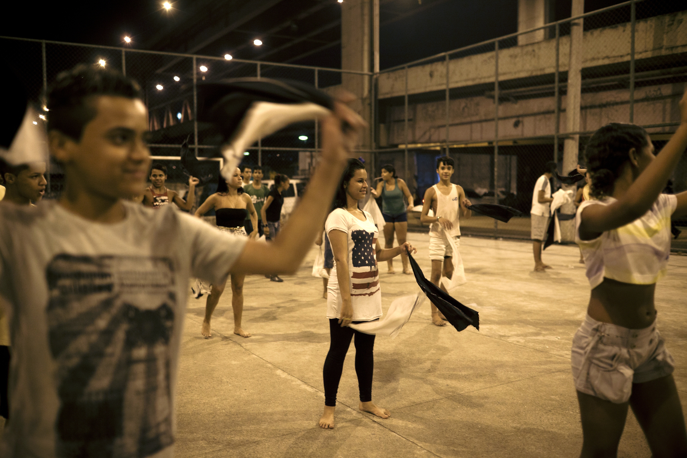 Youths in a Rio slum practice a dance in preparation for a festival.