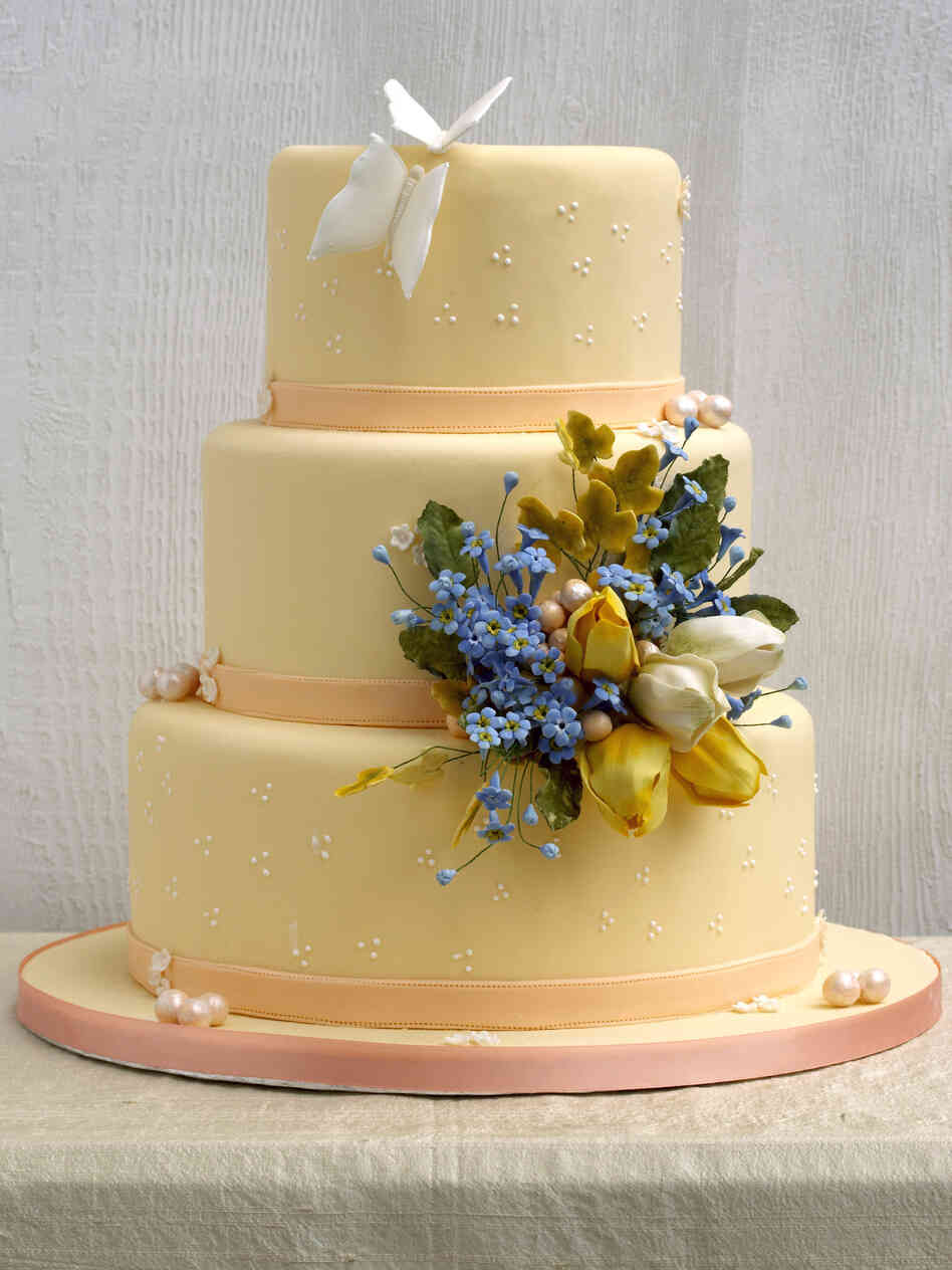 "The ""Flooded Butterfly and Closed Tulip Cake"" as pictured in Wedding Cake Art and Design."
