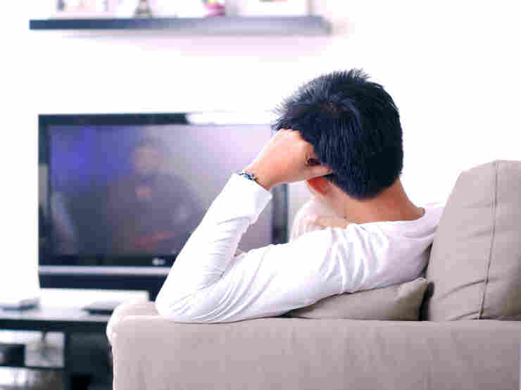 A guy watching television.