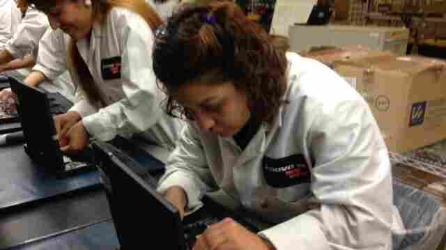 Johana Guardado assembles a laptop on Lenovo's new personal computer production line in Whitsett, N.C.