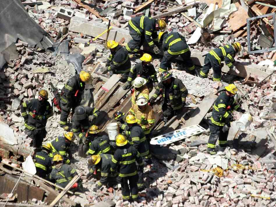 Firefighters and rescue workers at the site of Wednesday's building collapse in Philadelphia.