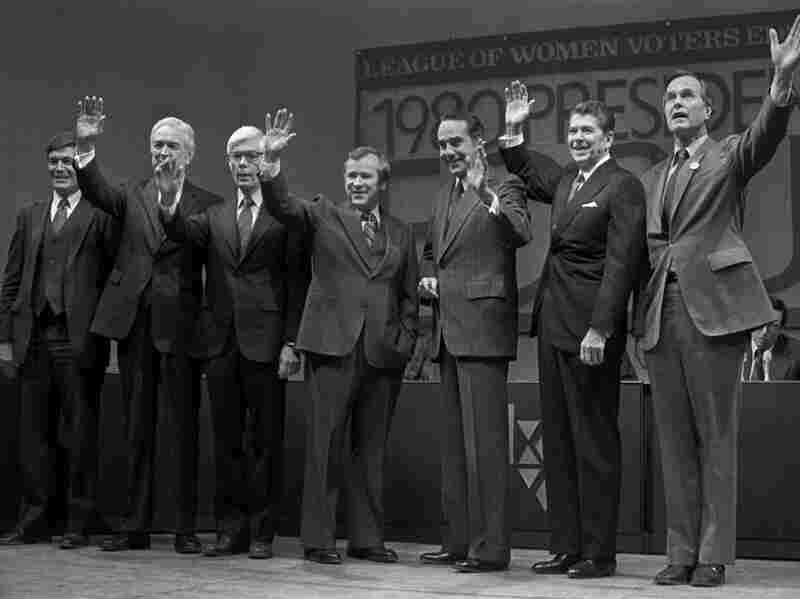 """GOP presidential contenders wave to the crowd in Manchester, N.H., in 1980, before a debate. From left"""" Philip Crane, John Connelly, John Anderson, Howard Baker, Robert Dole, Ronald Reagan and George H.W. Bush."""