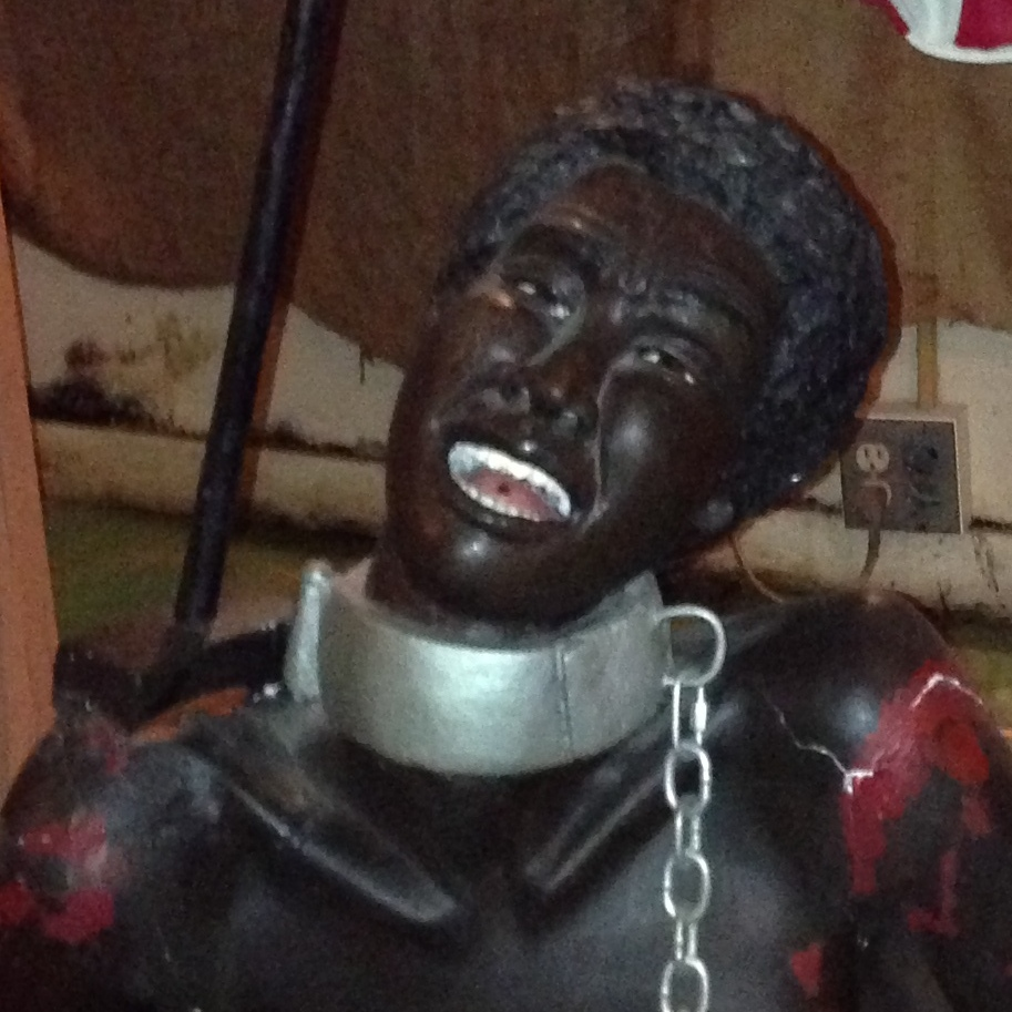 Life-size wax figures at the National Great Blacks in Wax Museum depict the grim realities of slavery.