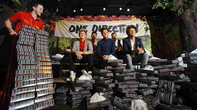 Madame Tussauds in London takes delivery of a bulk order of tissues after One Direction fans began to break down.