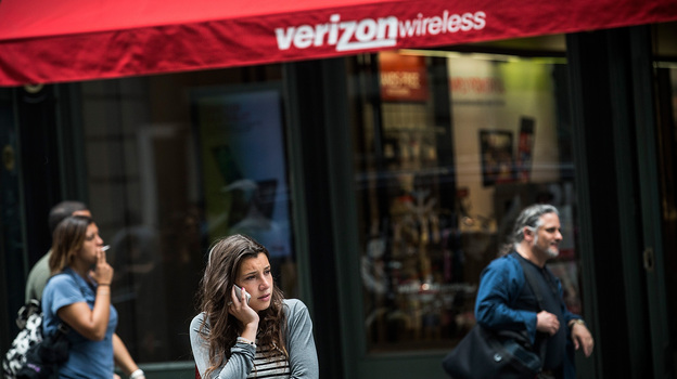 A woman uses her cellphone outside a Verizon Store in Manhattan on Thursday. (Getty Images)