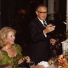 Henry Kissinger delivers a toast during dinner at Sunnylands. Carol Price is at left.