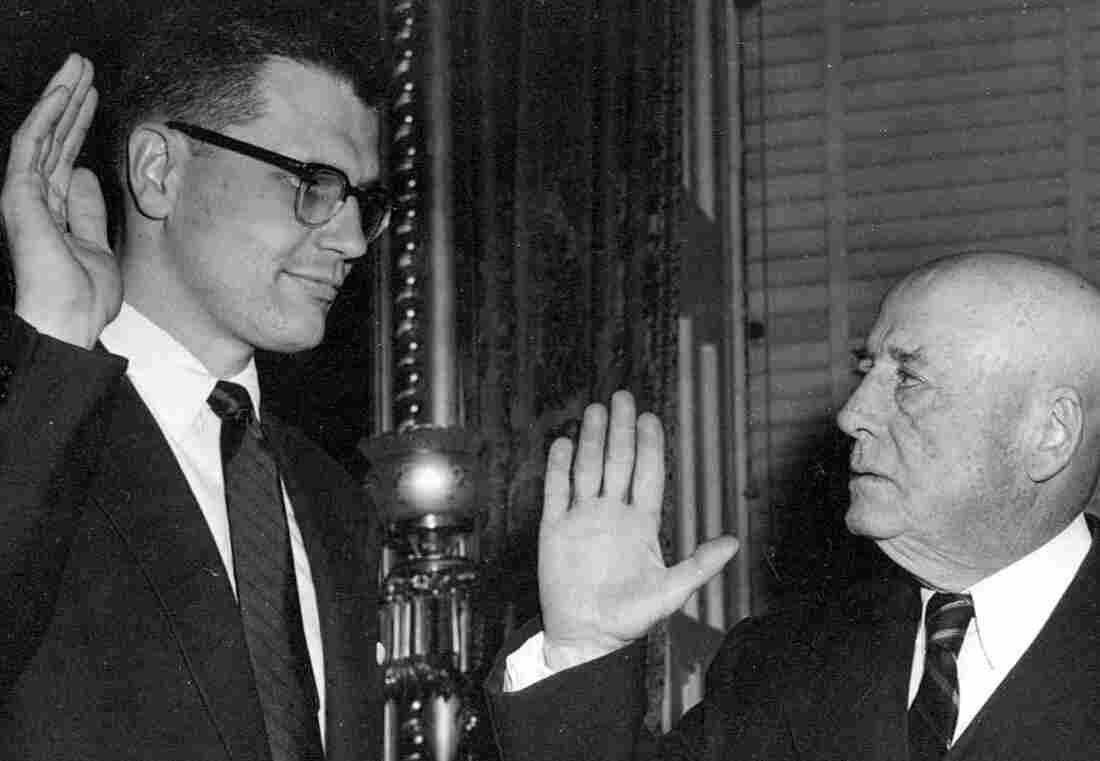This photo provided by Rep. John Dingell's office shows Dingell (left) being sworn in by Speaker of the House Sam Rayburn of Texas in 1955.