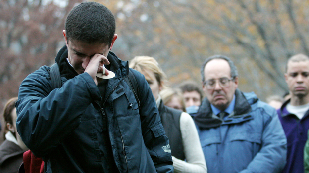 Student Kahlil Quato fights tears as he speaks at a University of Chicago candlelight vigil in 2007. The service was held in remembrance of Amadou Cisse, a graduate student, who was shot to death at point-blank range. (AP)