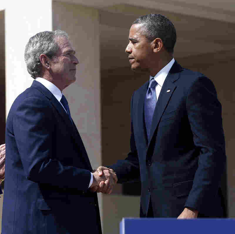 President Obama and former President George W. Bush are joined by more than a handshake. Their national security policies link them, too.
