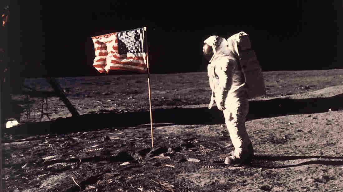 """Astronaut Edwin E. """"Buzz"""" Aldrin Jr. stands beside the U.S. flag on the moon during the Apollo 11 mission on July 20, 1969."""