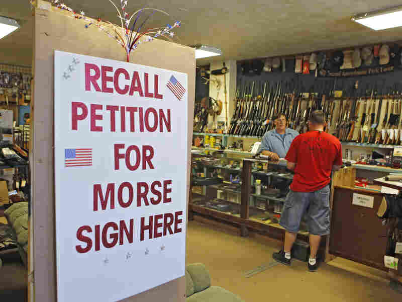 A sign posted at the entrance of Paradise Firearms in Colorado Springs invites customers to sign a recall petition against Colorado Democratic State Senate President John Morse.