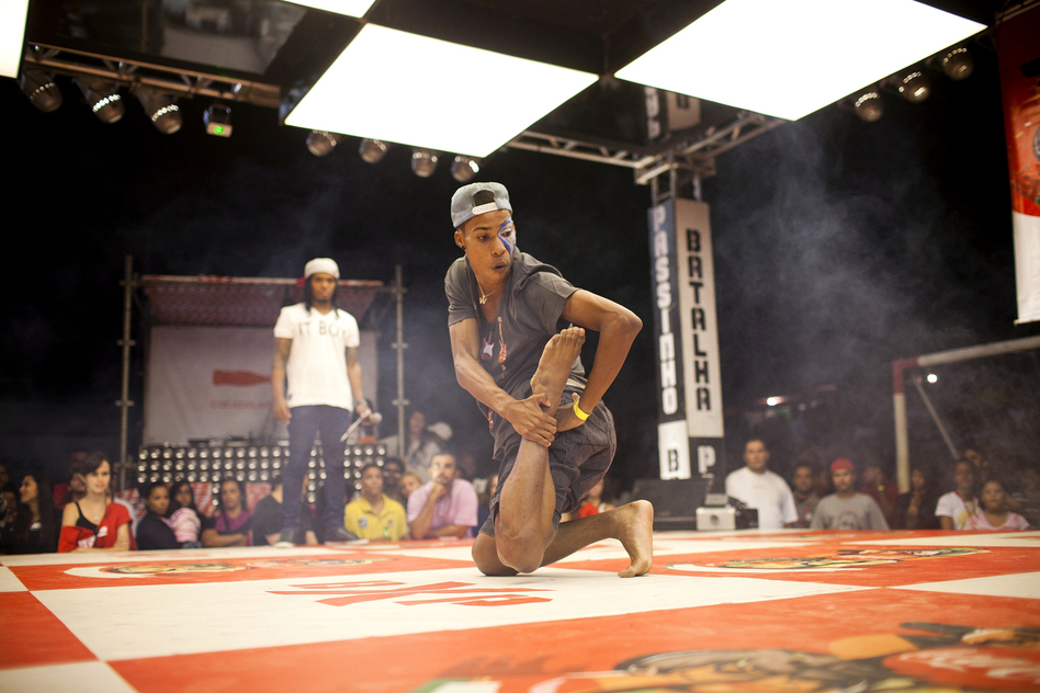 Wellington Costa, 19, performs at the semifinals of a <em>passinho</em> competition in Rio de Janeiro on April 23. <em>Passinho</em> is a liberated dance form born in Rio's <em>favelas</em>, or shanty towns.