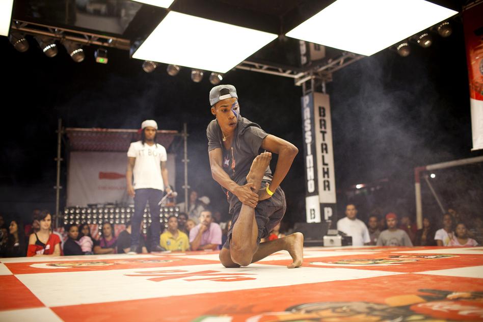 Wellington Costa, 19, performs at the semifinals of a <em>passinho</em> competition in Rio de Janeiro on April 23. <em>Passinho</em> is a liberated dance form born in Rio's <em>favelas</em>, or shanty towns.