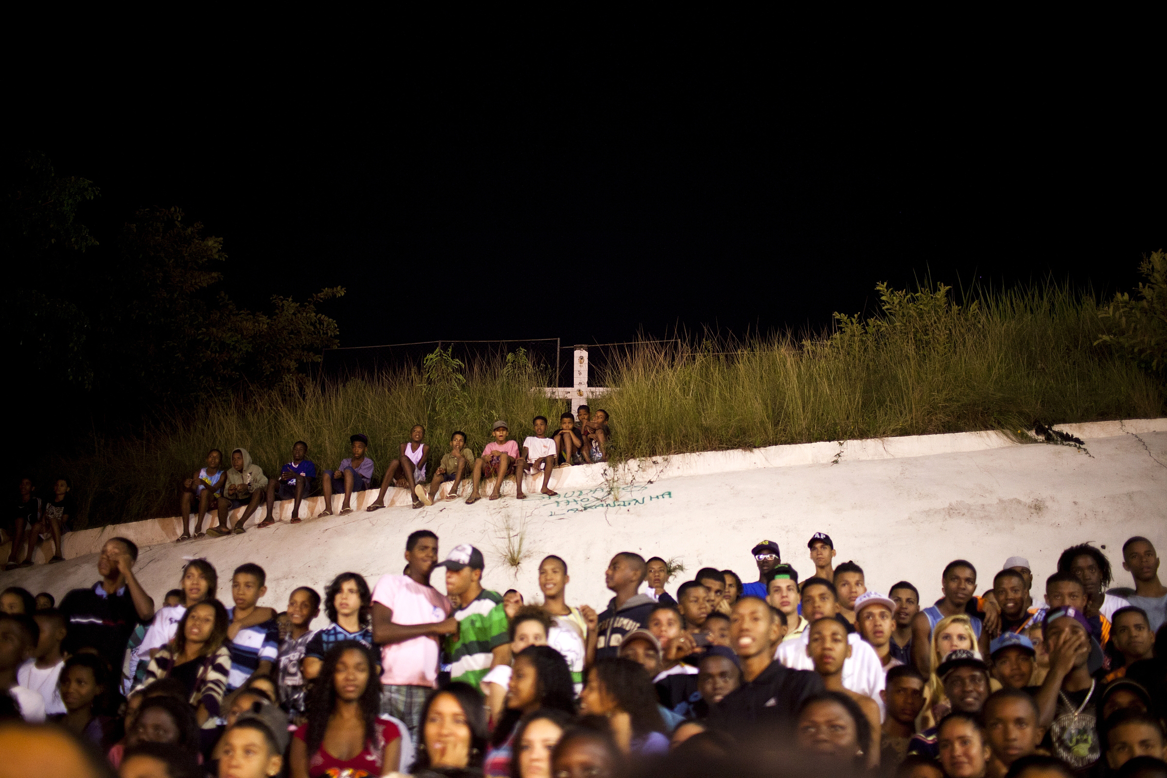 A crowd watches Batalha do Passinho, a dance competition. While some batalhas are large sponsored events, others break out at informal dance parties.