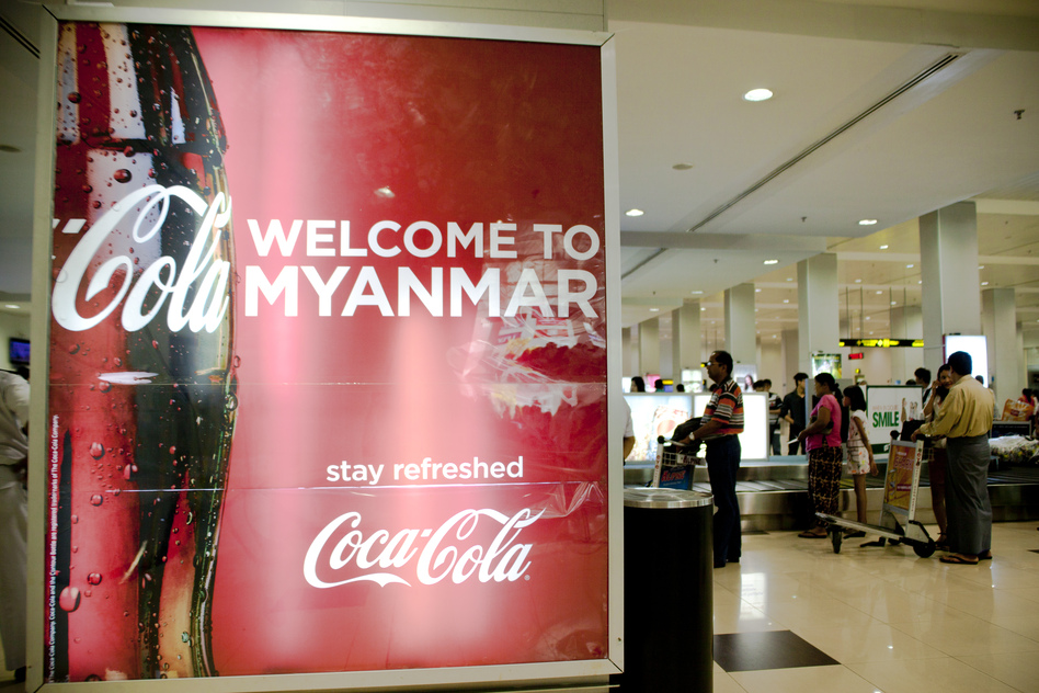 A Coca-Cola advertisement in the baggage claim area at the Yangon Airport in Myanmar. (NPR)