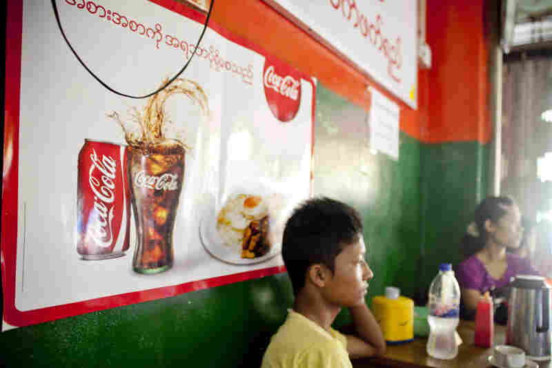 Coca-Cola advertisements have gone up in tea shops around the former Myanmar capital since the sanctions were lifted.