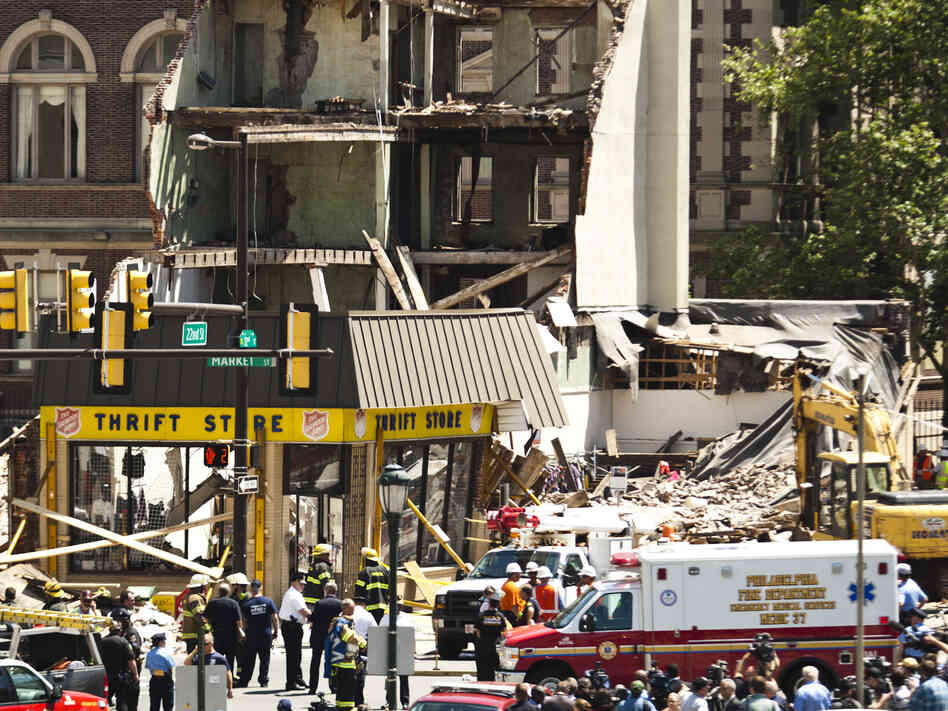Rescue workers converged Wednesday on the site of a building collapse in Philadelphia. At least six people were reportedly killed and an additional 14 injured.