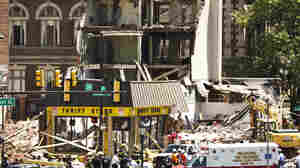Rescue workers converged Wednesday on the site of a building collapse