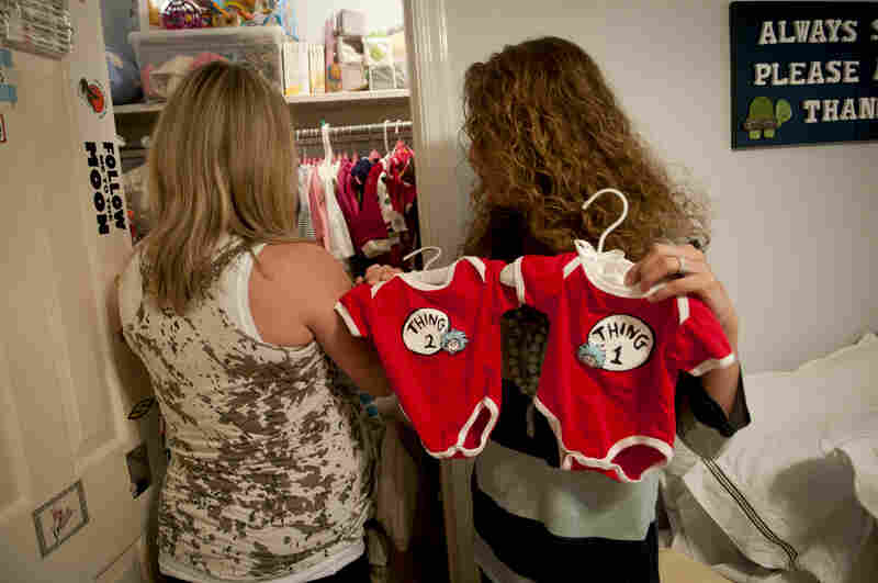 "Morales pulls out Dr. Seuss-inspired matching outfits for the twins while the couple arrange the nursery's closet. Costello says they ""don't' feel secure in our lives here...it's the instability, something we think about all the time."""