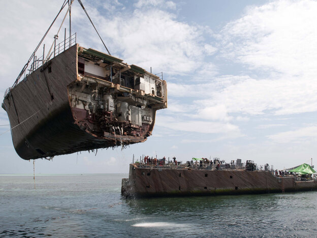 The bow of the mine countermeasure ship Guardian is removed in March in