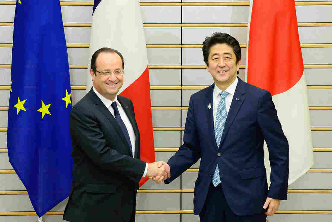 French President François Hollande is welcomed by Japanese Prime Minister Shinzo Abe prior to their meeting at Abe's official residence in Tokyo.