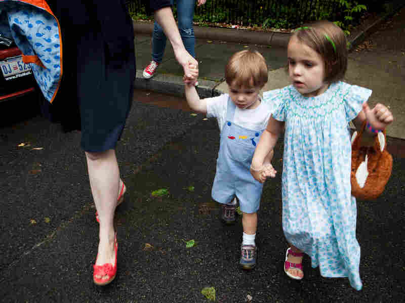 Eaddy Holmes, 4, holds her brother's hand as they cross the street. Sometimes she can't sleep because she worries he will have a seizure.