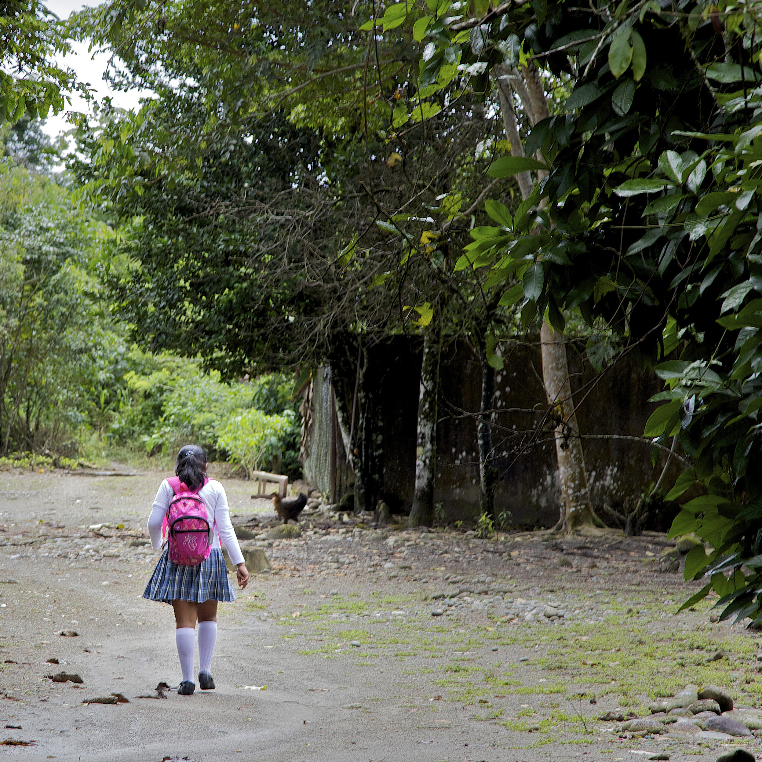 A schoolgirl walks home from school in El Pacer, Colombia. Paramilitary forces allied with the Colombian government against Marxist FARC guerrillas took over El Pacer in 1999 and controlled it through violence, including widespread rape.