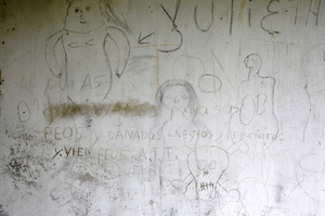 Sexually explicit drawings and graffiti remain on the walls of an abandoned building once occupied by paramilitary troops.