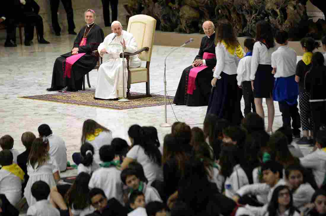 Pope Francis speaks with Jesuit school students Friday at the Vatican.