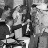 President Kennedy passes out pens on June 10, 1963, after signing the Equal Pay Act.