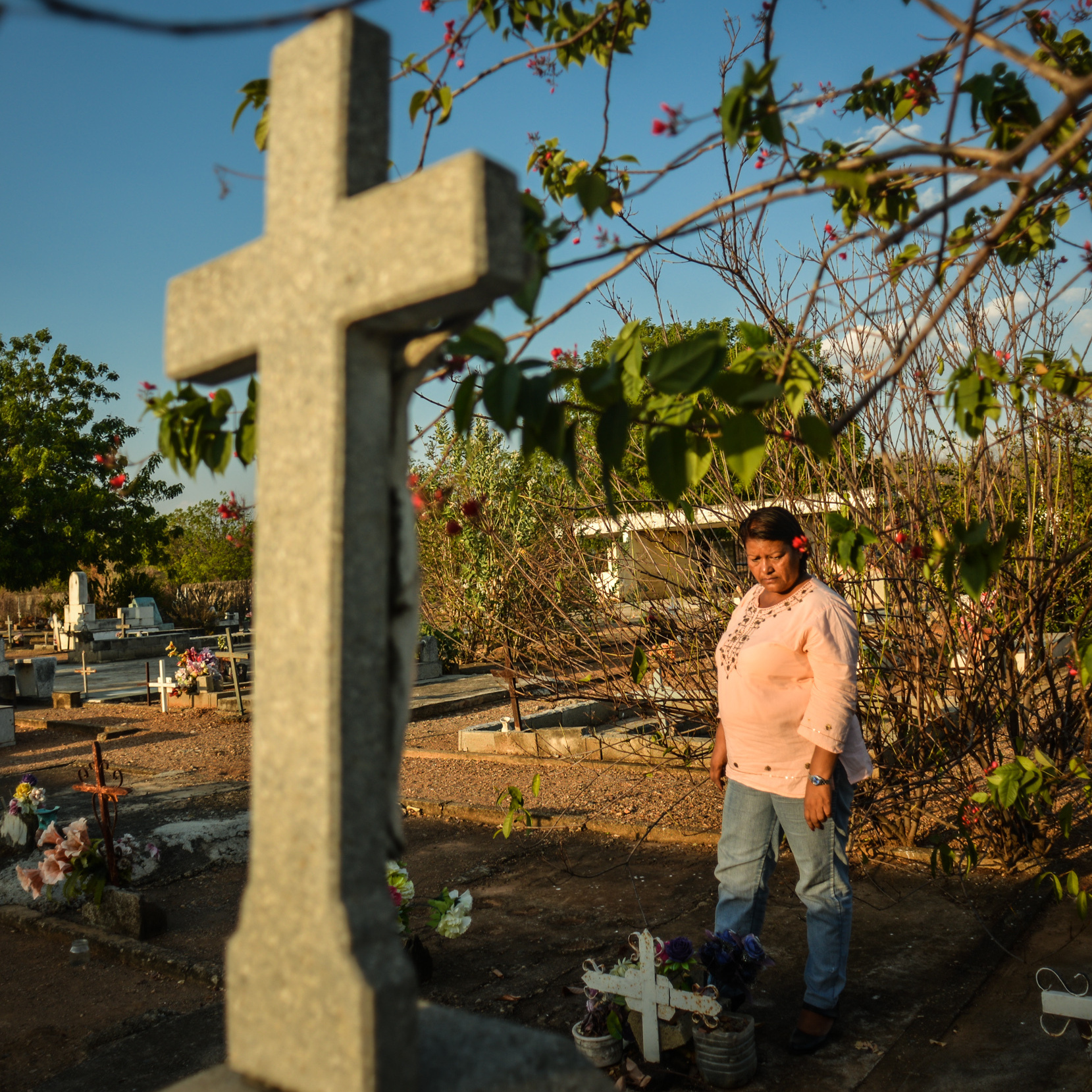 Eloisa Barrios visits the humble graves of nine male family members in the Guanayen cemetery. She says all nine were killed by the police, in what was a vendetta against her family. Recently, a 10th member of the family was stabbed to death. He was 17.