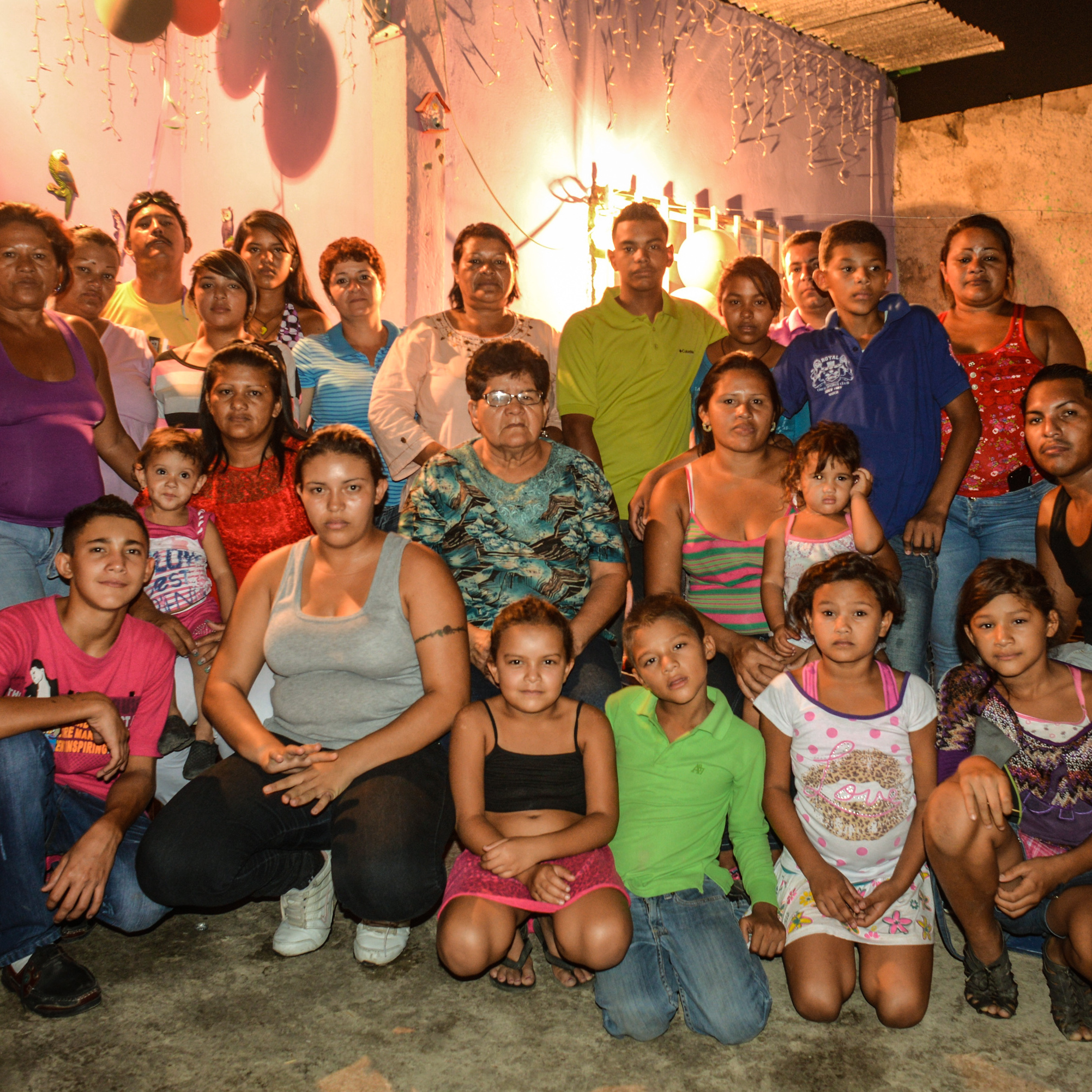 "Members of the Barrios family pose for a family portrait during a birthday party at a family home in Cagua, Venezuela. Nine men in the Barrios family have been allegedly murdered by the police. The party was largely attended by female family members -- when asked why, several women said in unison, ""because there aren't any men left."""