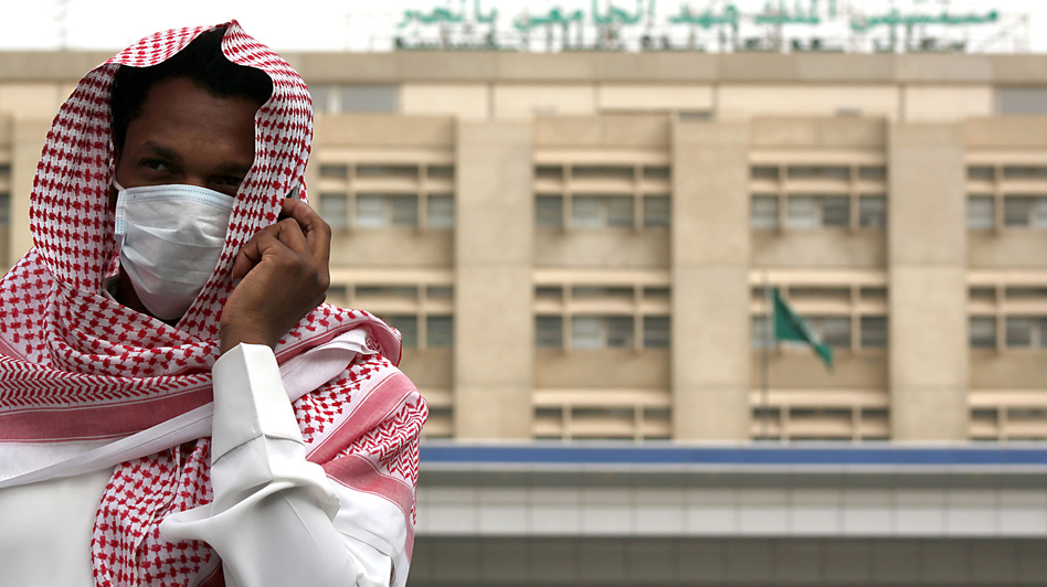 A man outside a hospital in Dammam, Saudi Arabia, wears a surgical mask as a precaution against a coronavirus that has killed 31 people worldwide. (Reuters/Landov)