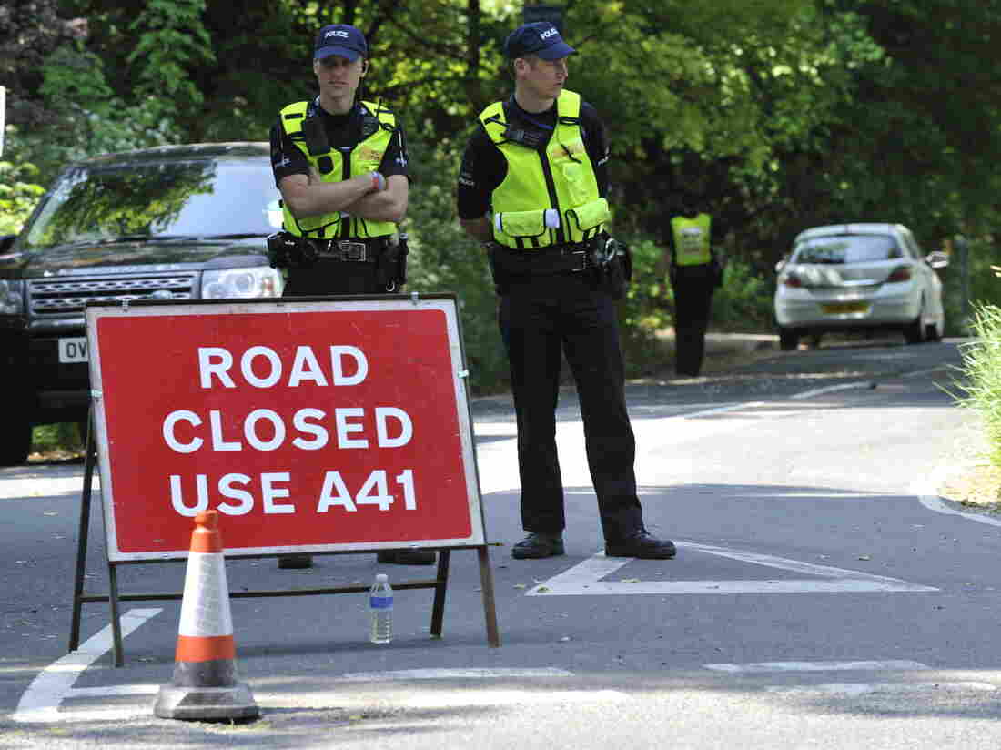 """What goes on up the road is only for those in the know to know: Police stood guard Thursday near the Grove Hotel in Watford, England, where """"The Bilderberg"""" group is meeting this year."""