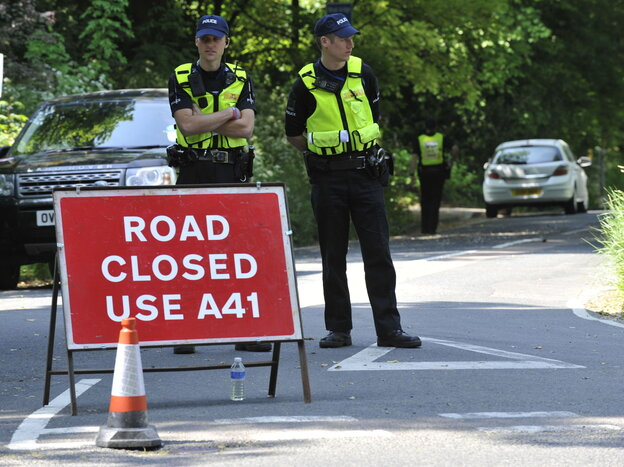 "What goes on up the road is only for those in the know to know: Police stood guard Thursday near the Grove Hotel in Watford, England, where ""The Bilderberg"" group is meeting this year."