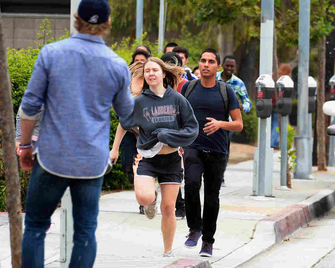 Students rush to safety after shots were fired near the Santa Monica College Friday. According to reports, at least six pe